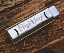 FlashHarp Harmonica USB on log