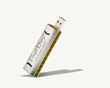 FlashHarp harmonica USB on gray background, angled.